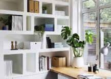 Curated-and-well-lit-modern-white-home-office-with-smart-bookshlef-and-a-wooden-desk-11725-217x155