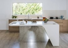 Custom-kitchen-island-with-a-mirrored-section-and-flowing-form-designed-by-Charlotte-Raynaud-and-Menuiserie-Hegenbart-99556-217x155