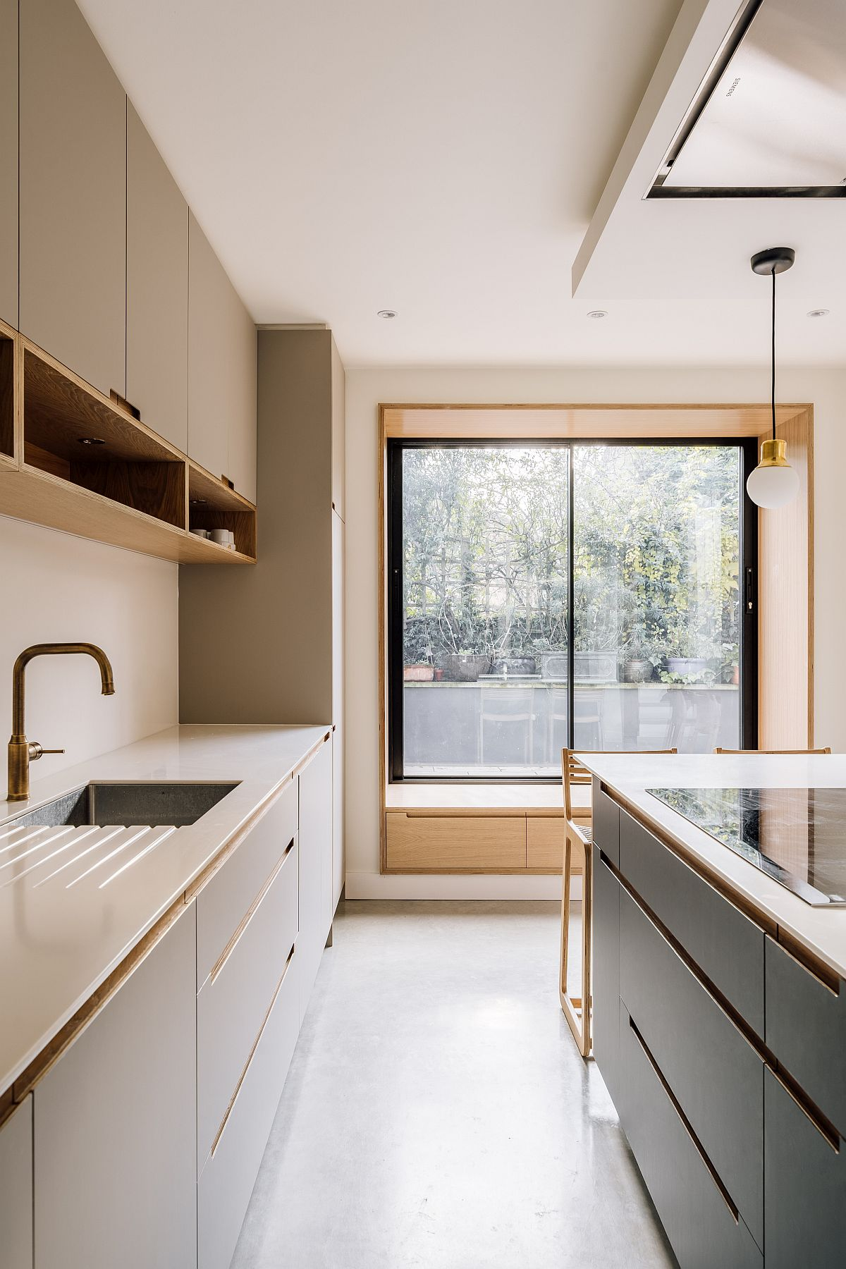 Custom oak window of the rear extension brings light into the modern kitchen