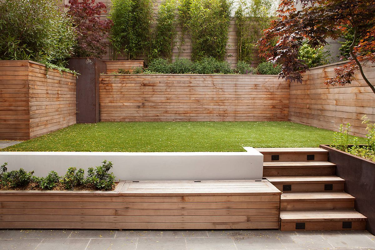 Custom wooden bench in the backyard aso serves as a storage option