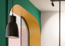 Dark-green-and-bright-yellow-shape-the-backdrop-of-the-apartmen-while-pops-of-black-anchor-it-68257-217x155
