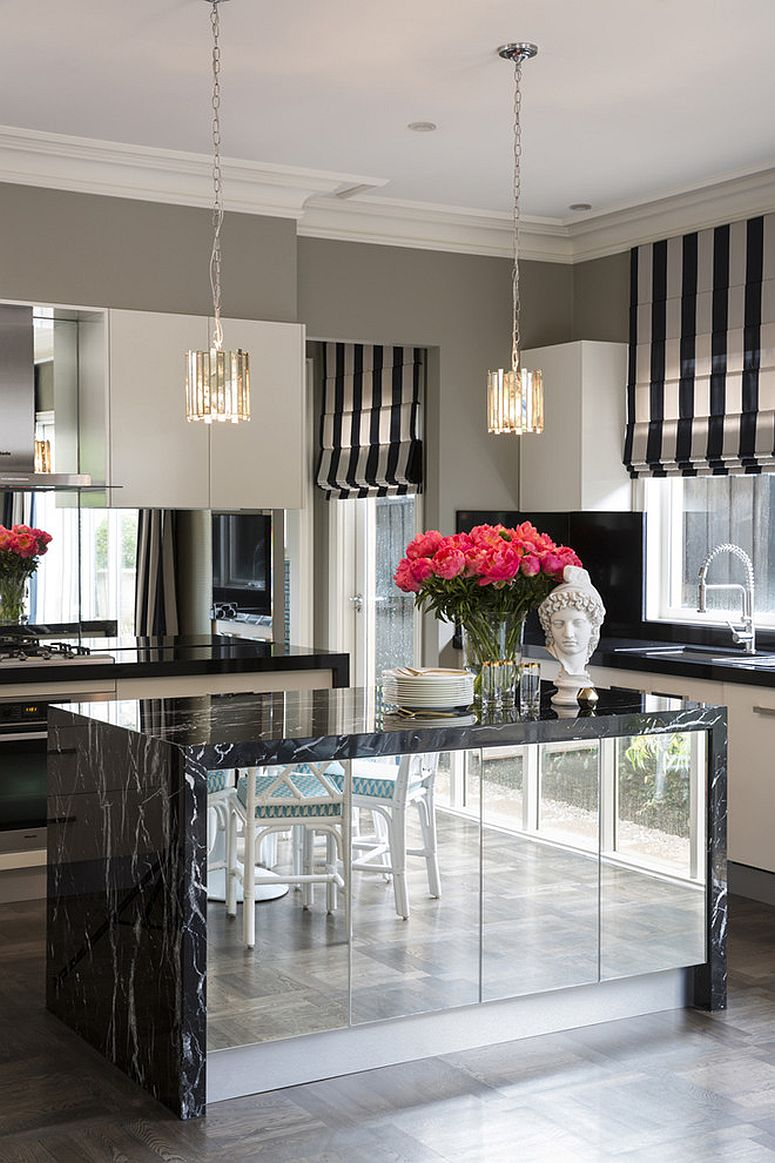 Dashing kitchen island with marble countertops and a glossy mirrored finish
