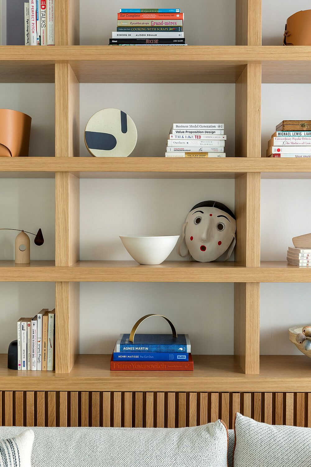 Decorate that open wooden bookshelf in a smart and modern fashion