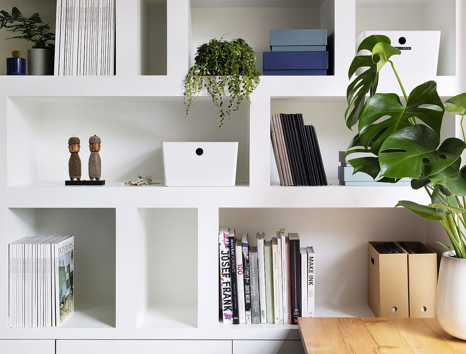 Decorating the modern bookshelf in white with books and more!