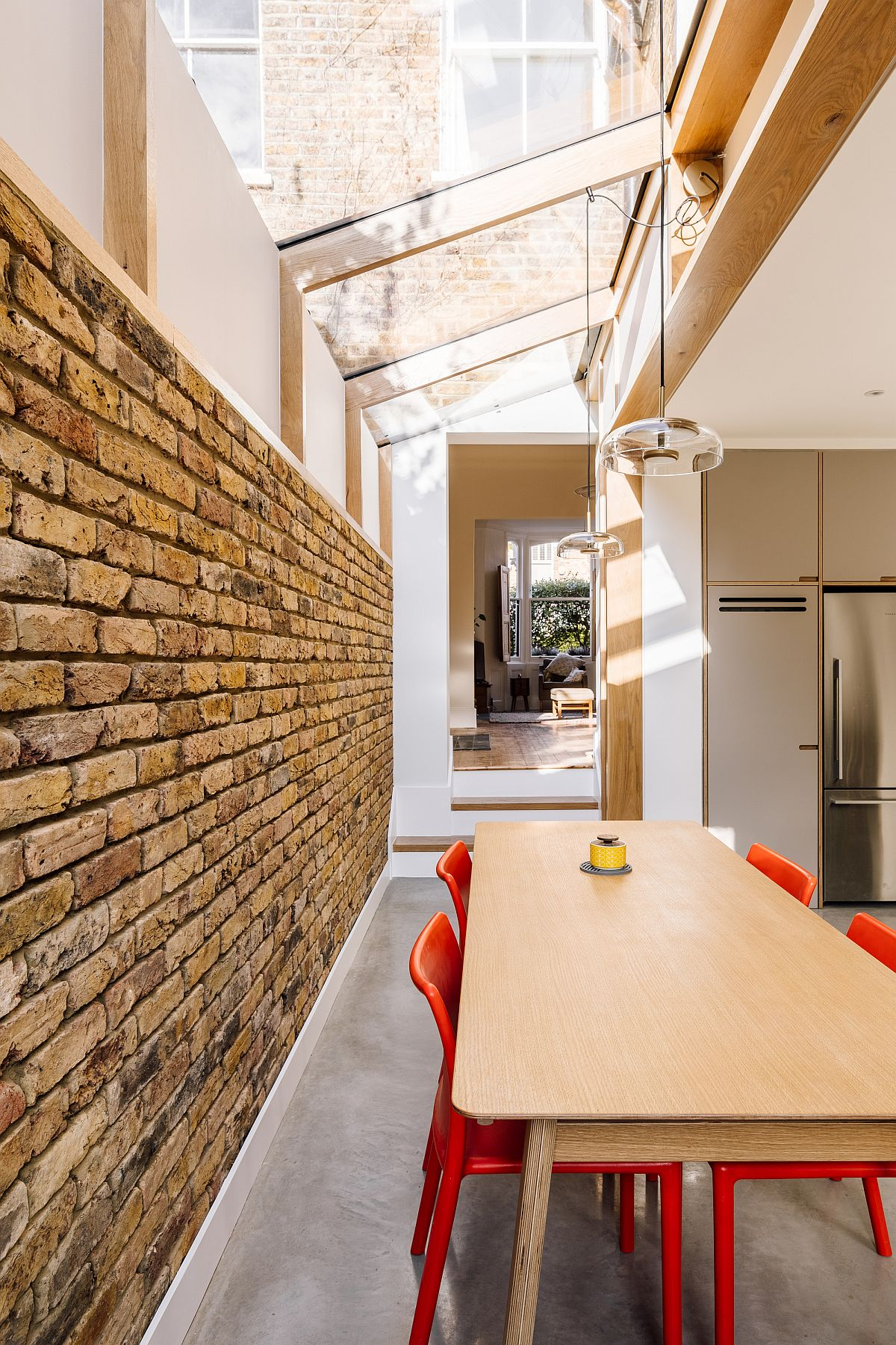 Dining area under the roof light of the kitchen gives you the experience of eating outdoors