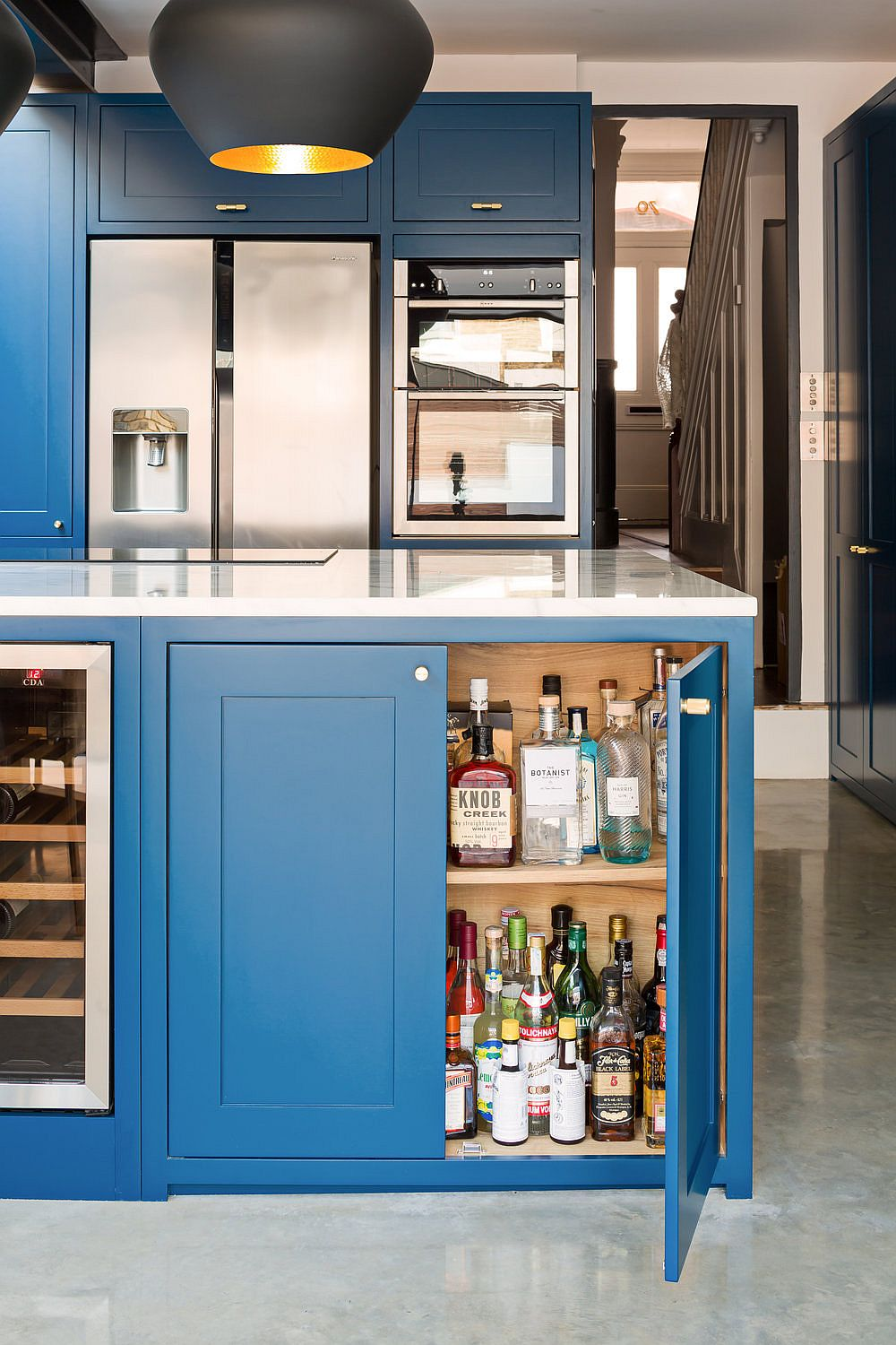 Doors of the kitchen island swing open to reveal ample storage space