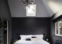 Double-height-master-bedroom-in-gray-and-white-with-sloped-ceiling-and-skylights-68391-217x155