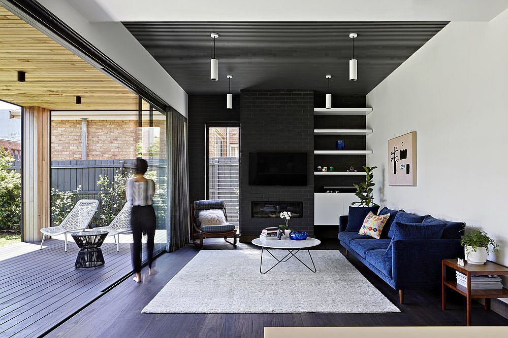 Drapes and sliding doors connect the interior with the lovely backyard