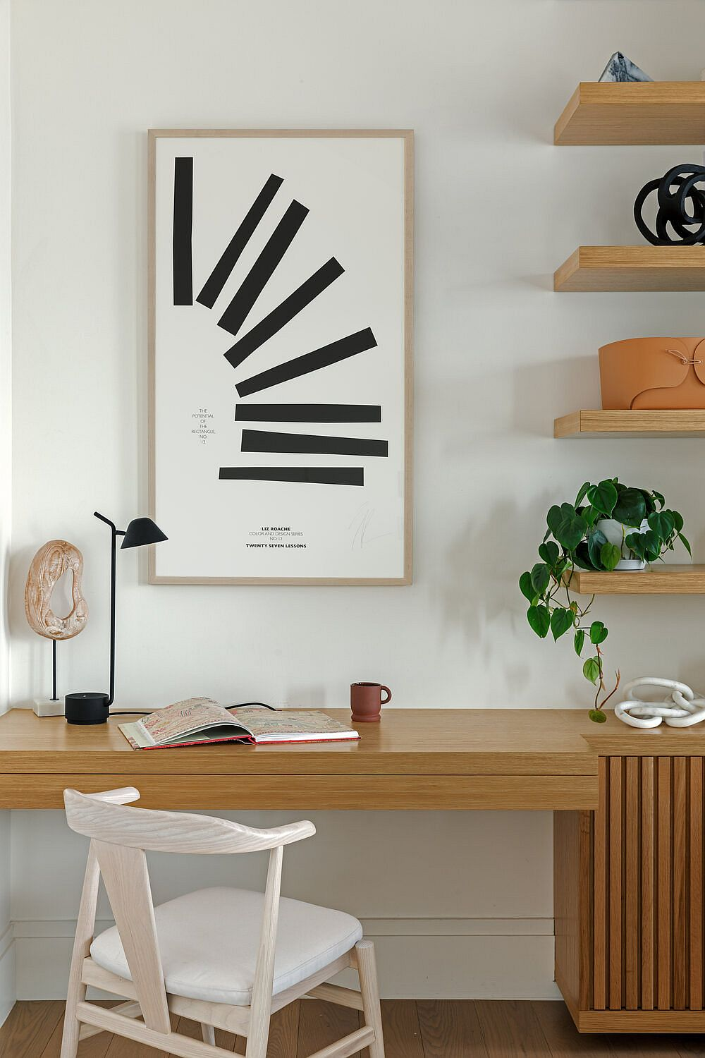 Easy and elegant home workspace created using a floating wooden desk and comfy chair