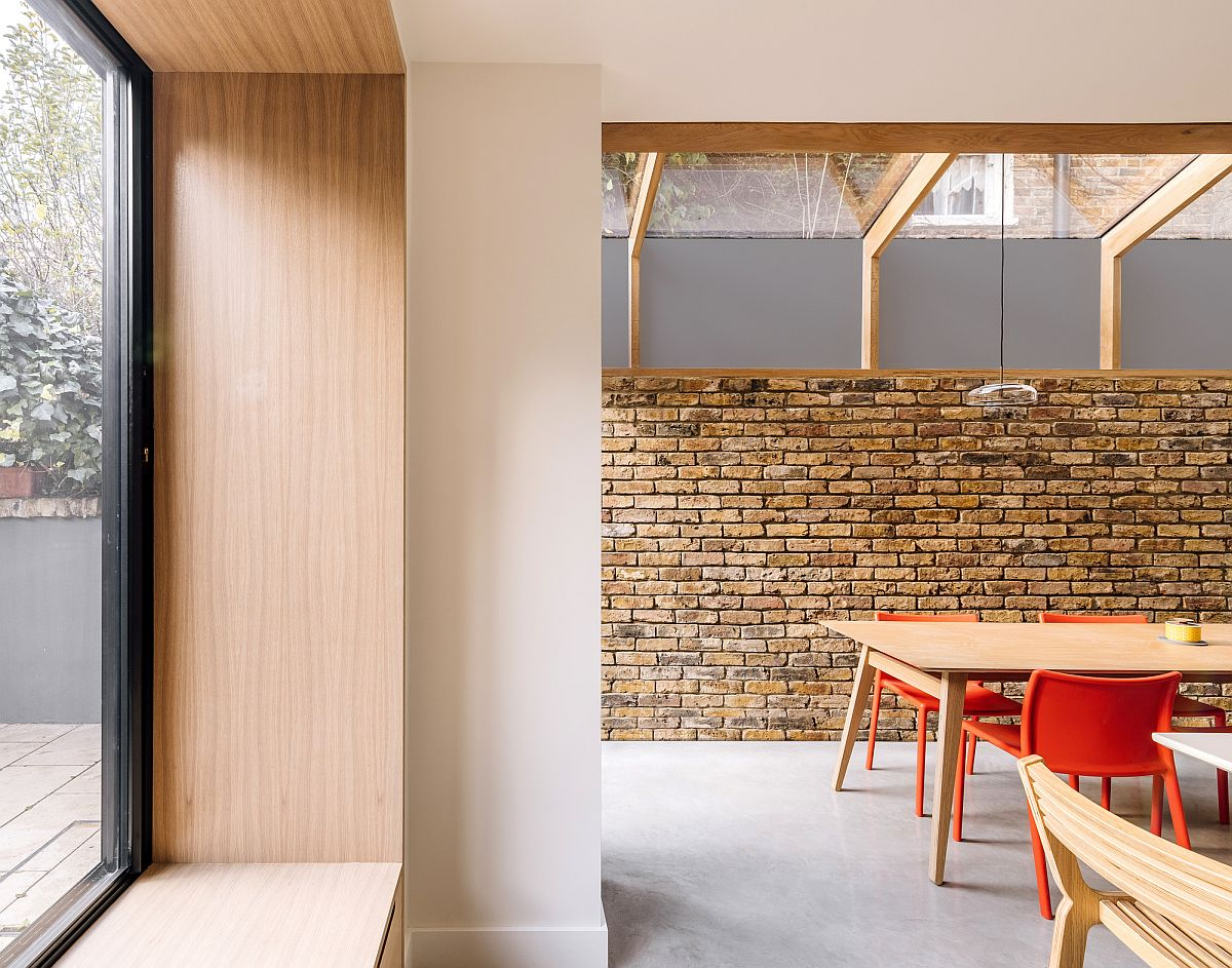 Exposed brick walls, polished concrete floor and oak finishes find space next to one another inside this London home