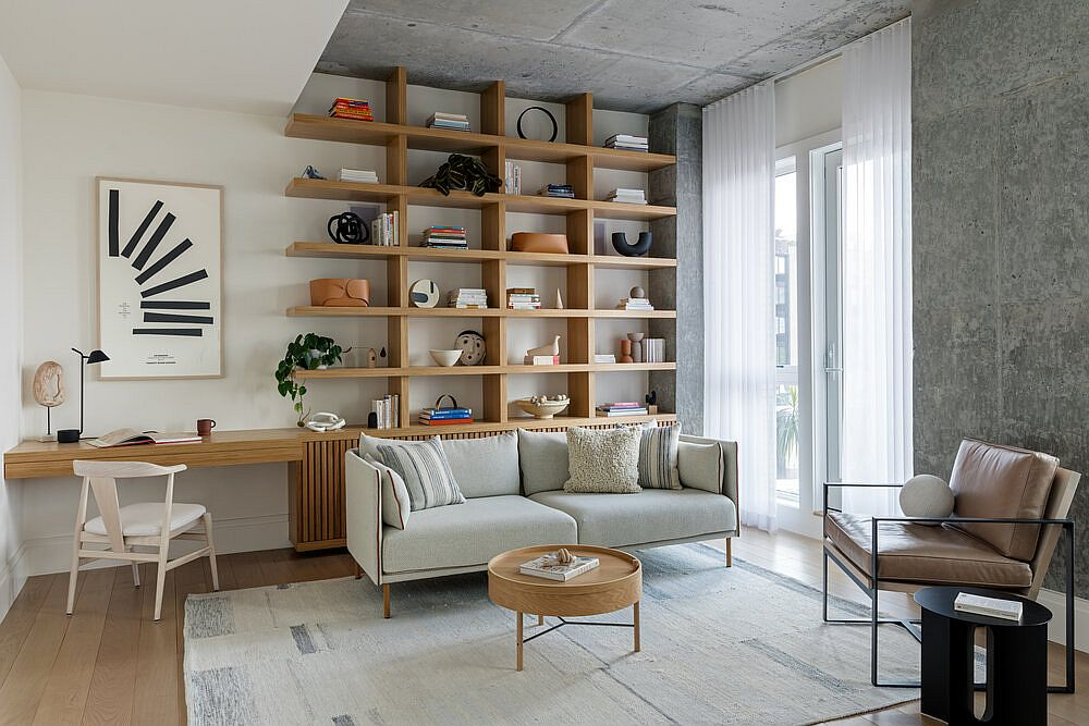 Exposed concrete ceiling and walls are combined beautifully with white walls and wooden shelving