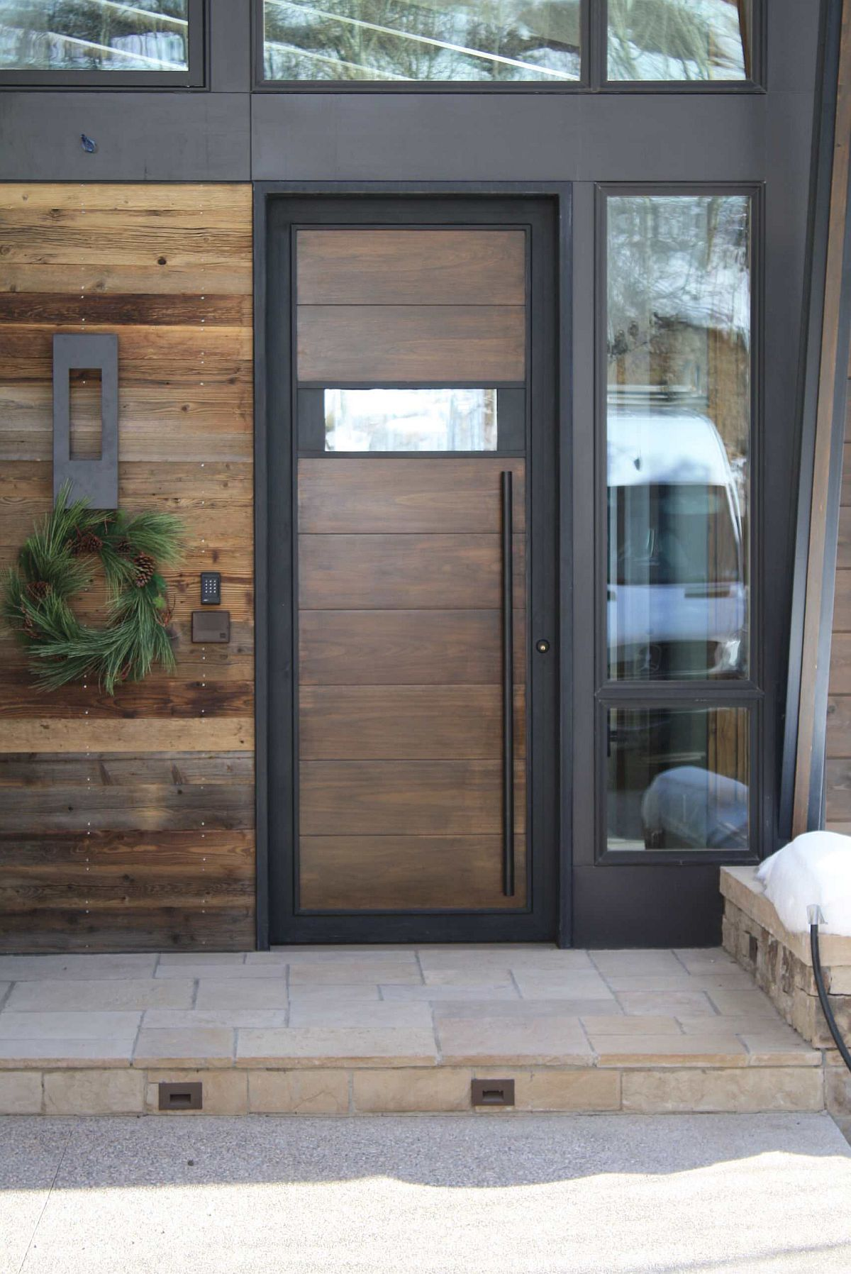 Exquisite reclaimed barn wood is carefully coupled with modern finsihes in this entryway