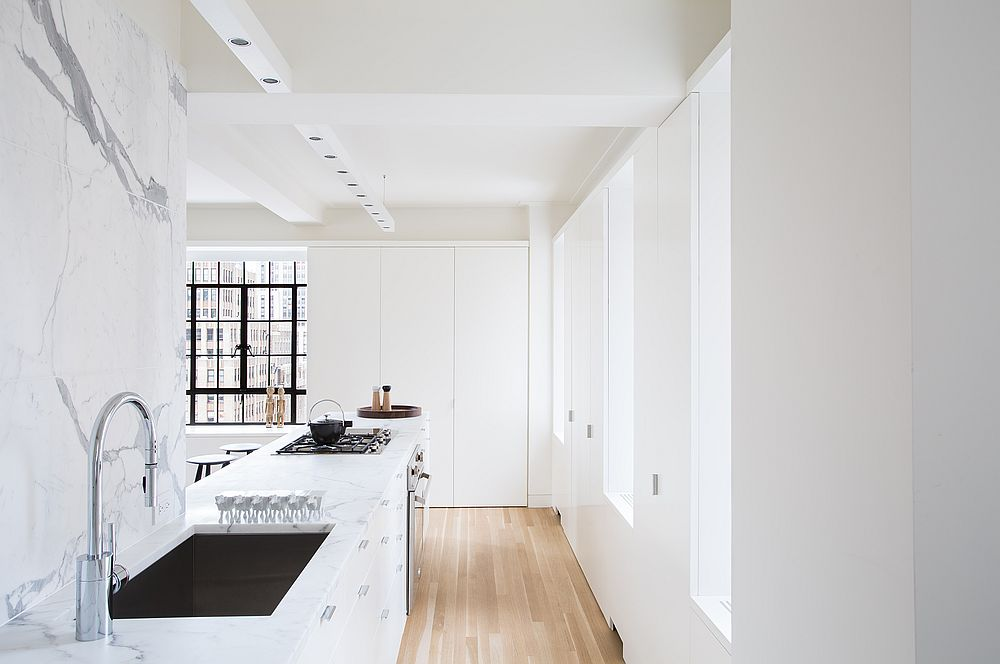 Exqusiite-white-kitchen-of-NYC-apartment-with-marble-countertops-and-backsplashes-along-with-white-lacquered-cabinets-37968
