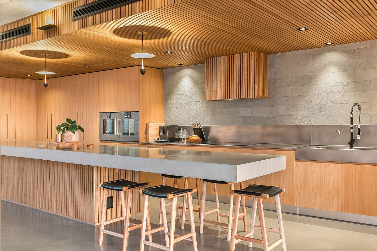 Extend the kitchen island to create a space-savvy eat-in kitchen that is the perfect social zone