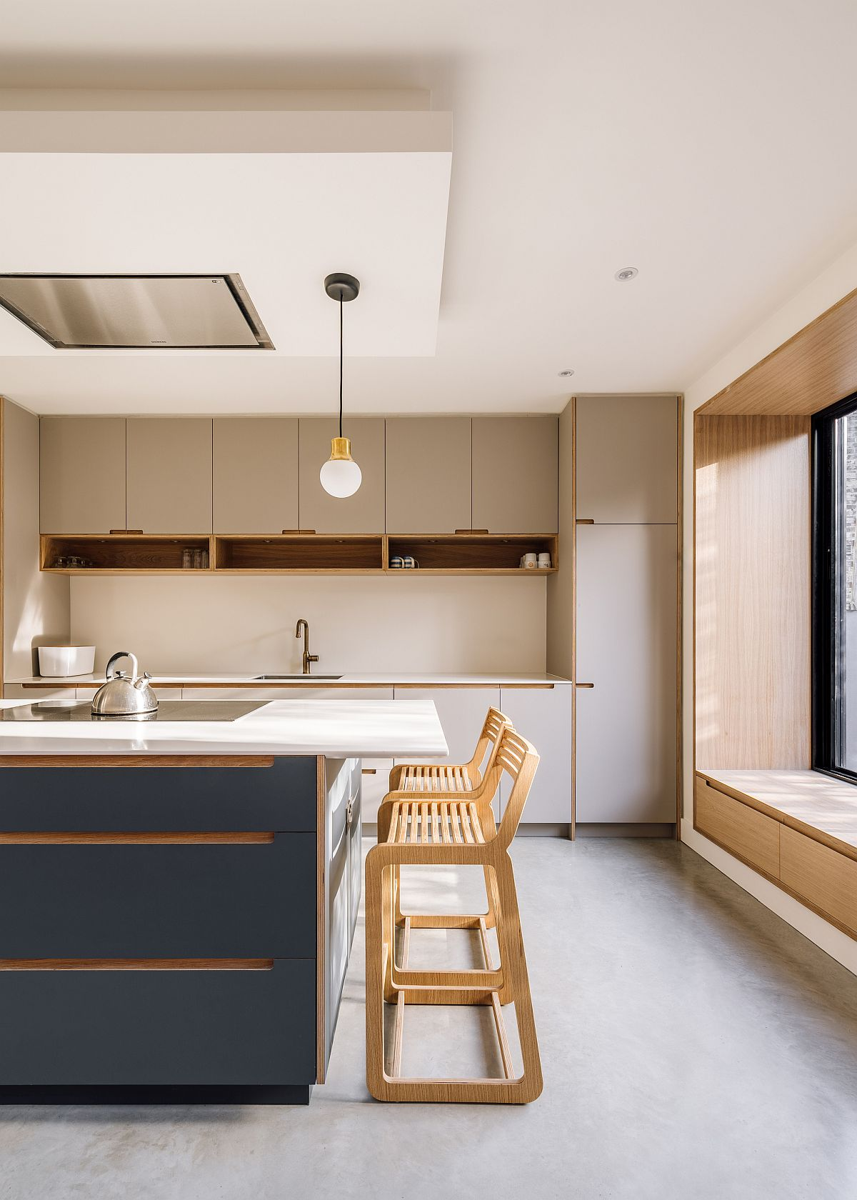 Fabulous bluish-gray central island of the spacious new kitchen with roof light