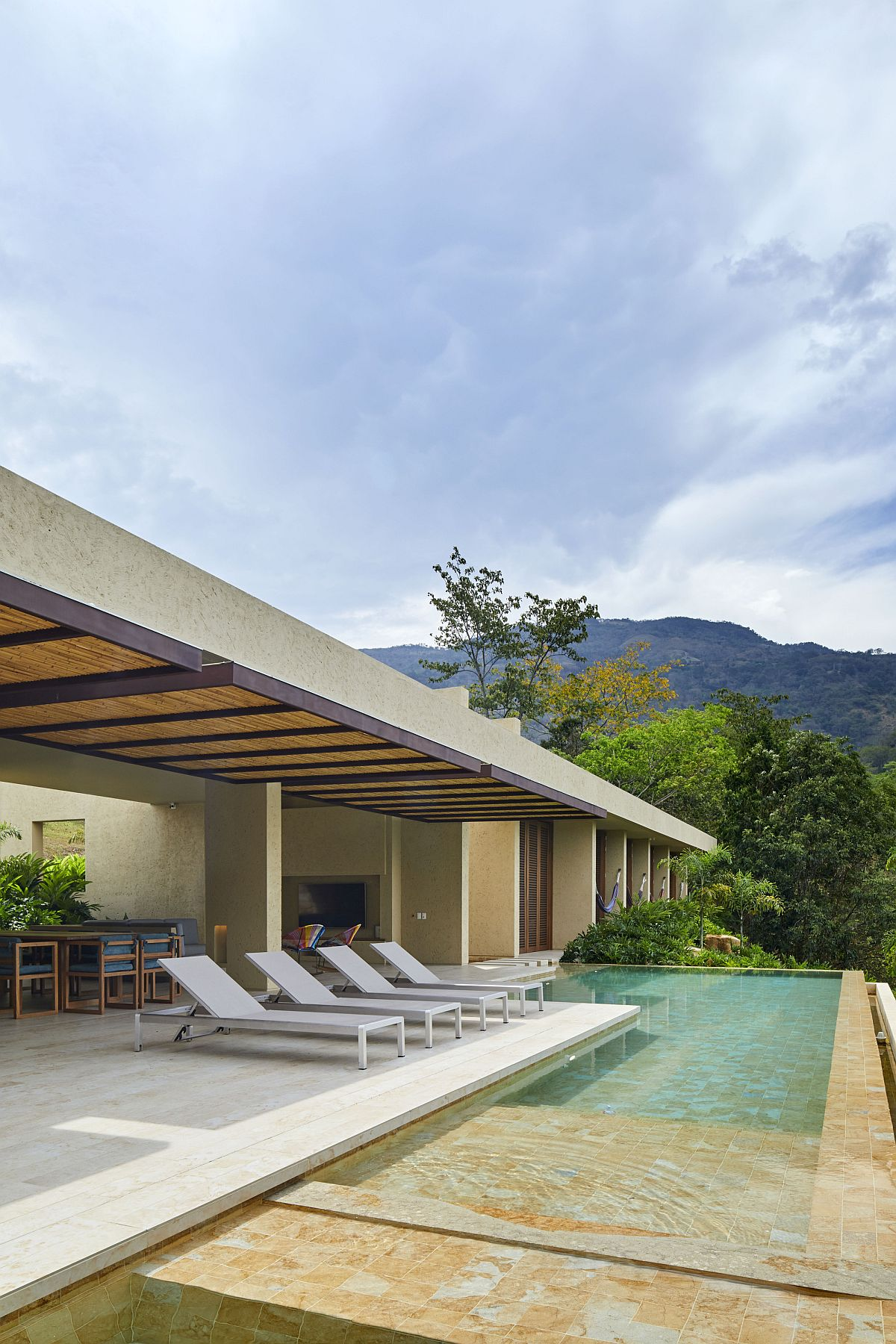 Fabulous deck and pool area of the house are directly connected with the open plan living space