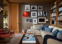 Family-room-with-gallery-wall-on-one-side-and-bookshelves-on-the-other-12628-217x155