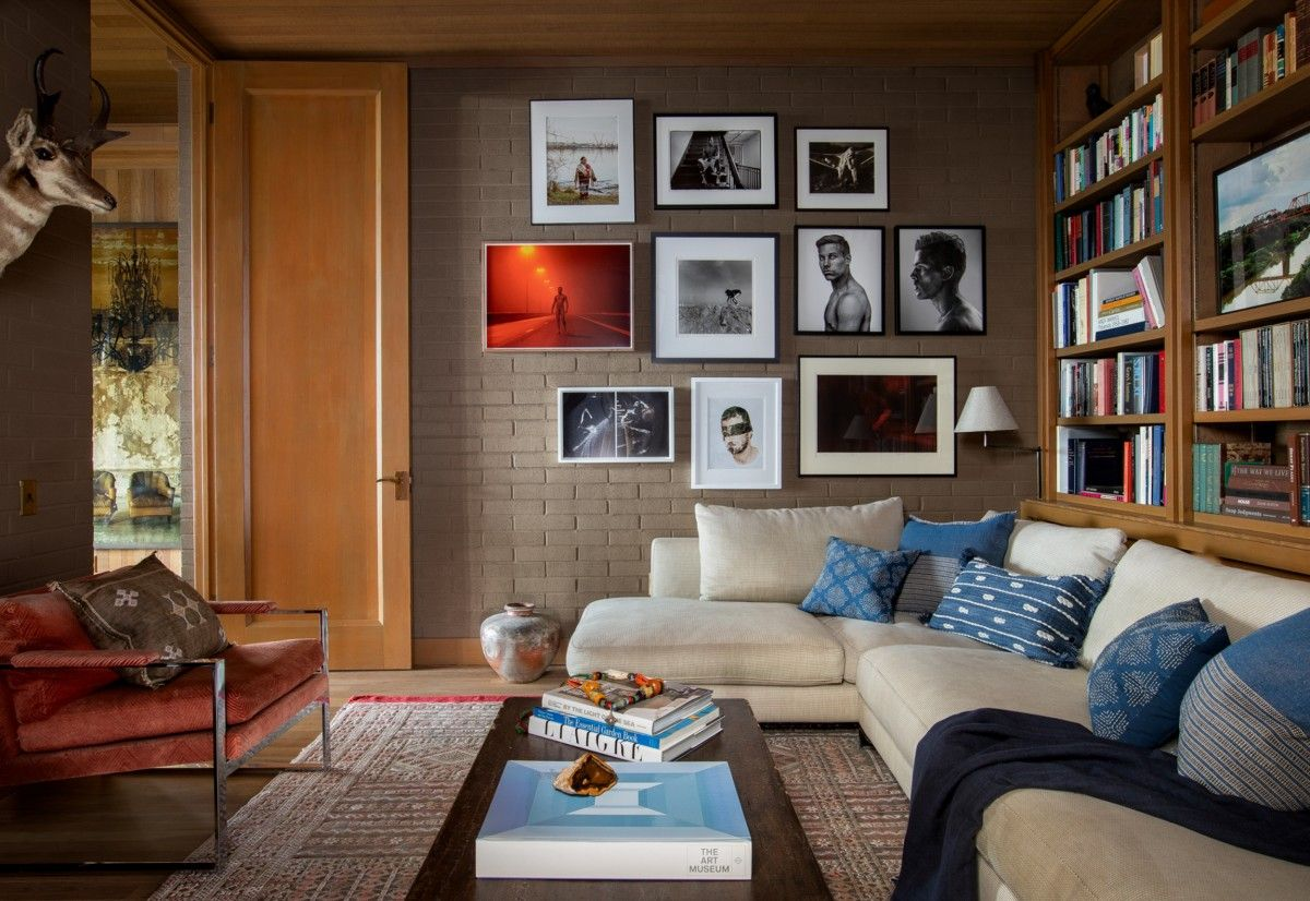 Family room with gallery wall on one side and bookshelves on the other