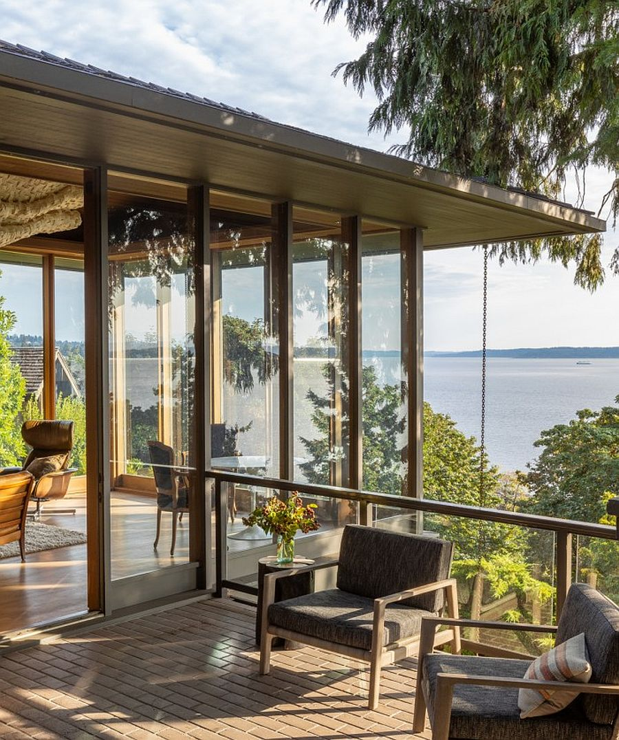 Glass-walls-on-the-upper-level-completely-open-up-the-interior-to-the-scenic-landscape-outside-77015