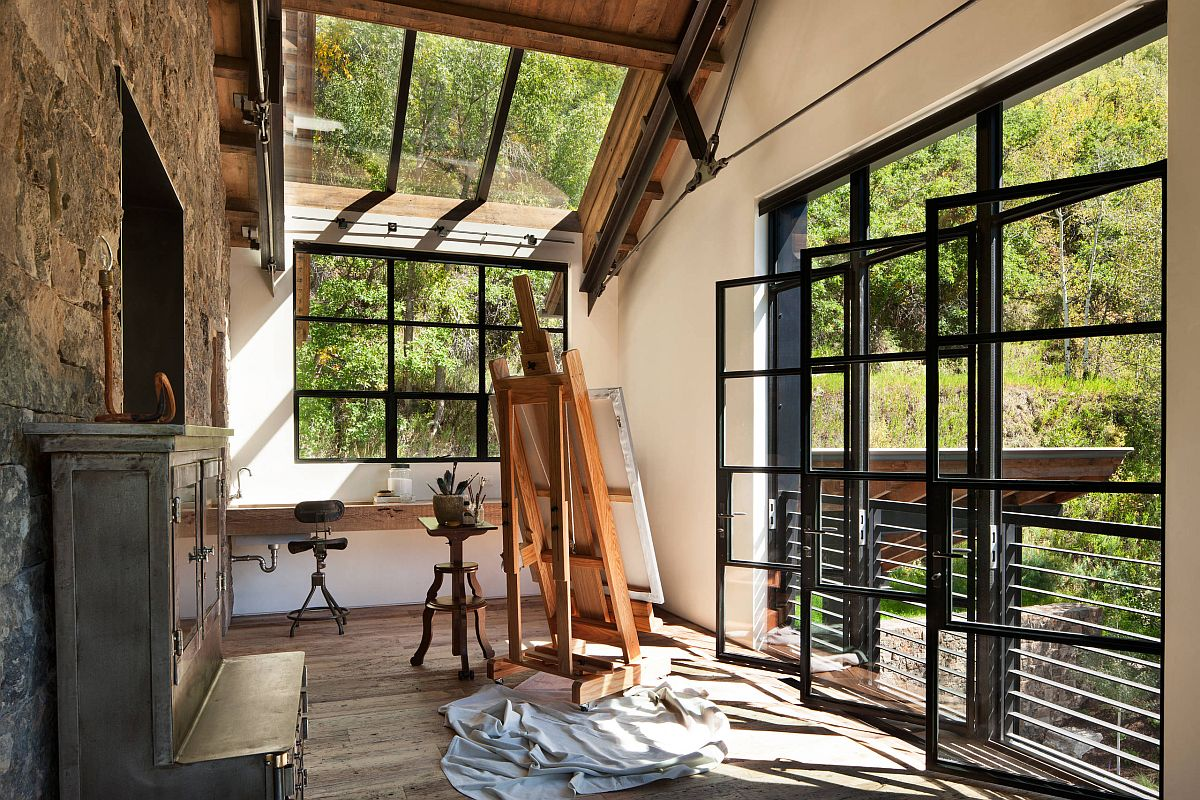 Glass-walls-windows-and-skylights-bring-in-the-scenic-view-and-light-while-keeping-noise-out-of-this-rustic-home-office-18284