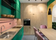 Gorgeous-and-colorful-kitchen-with-pink-tiled-backsplash-wooden-cabinets-and-a-felxible-kitchen-island-13144-217x155