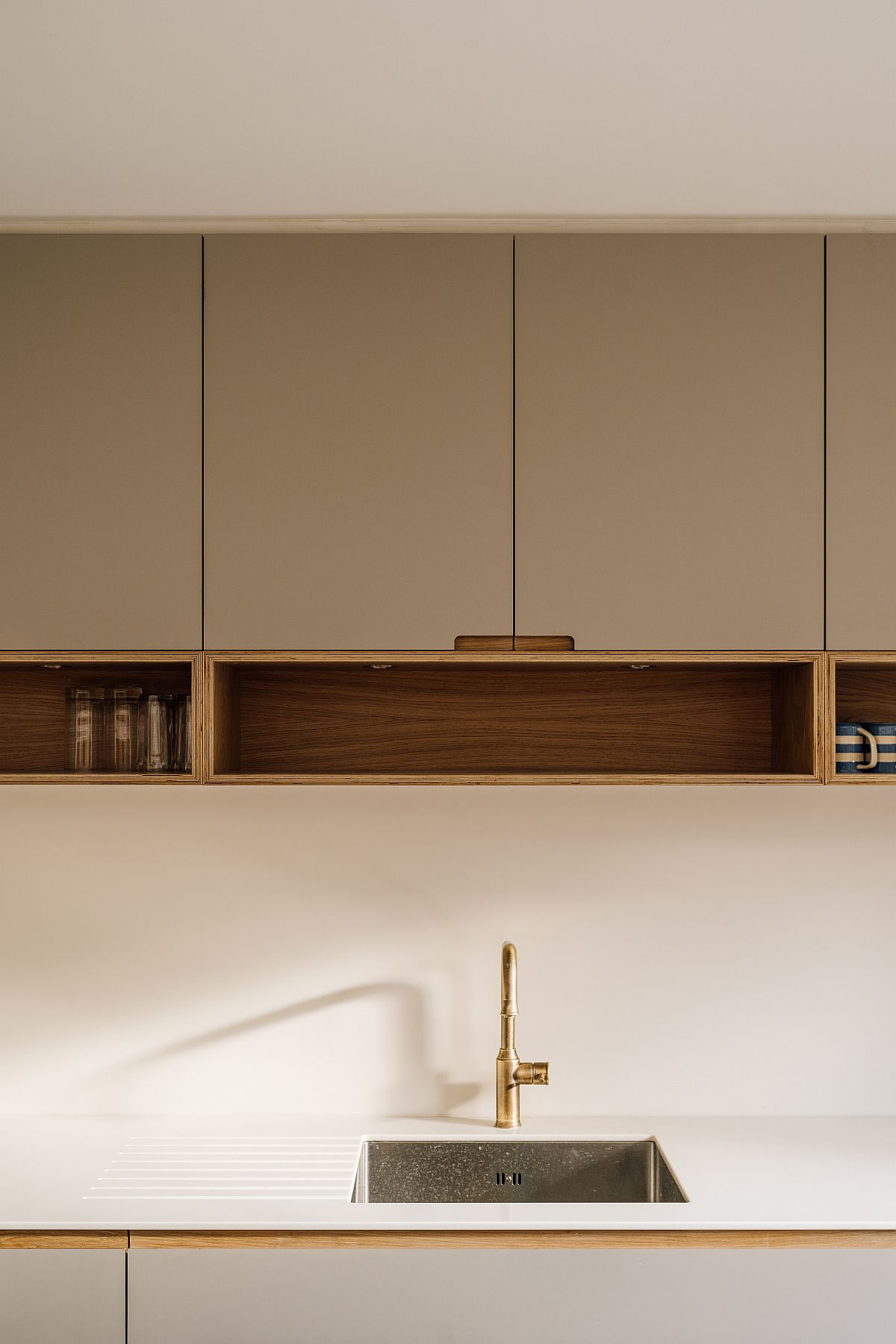 Gorgeous kitchen cabinets in laminated plywood along with oak accents