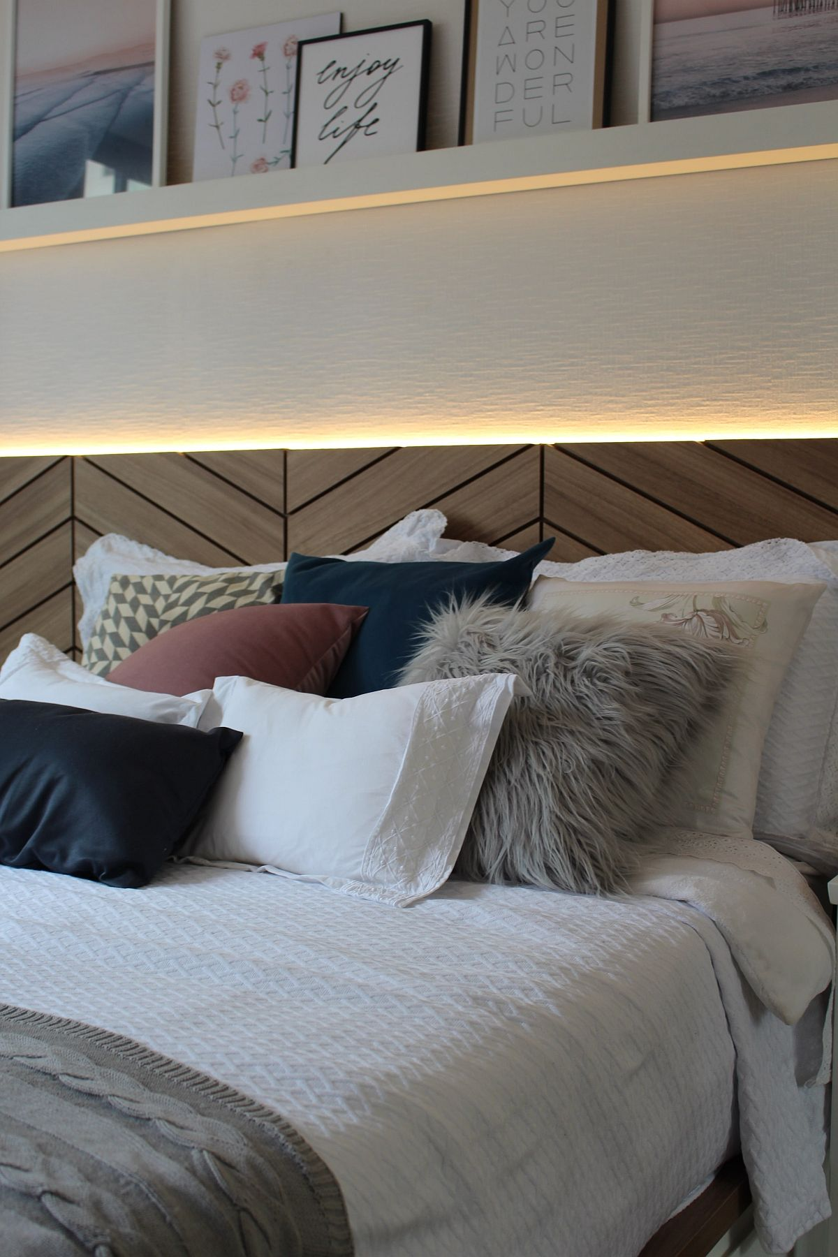 Gorgeous wood headboard with herringbone pattern and lovely LED strip lighting