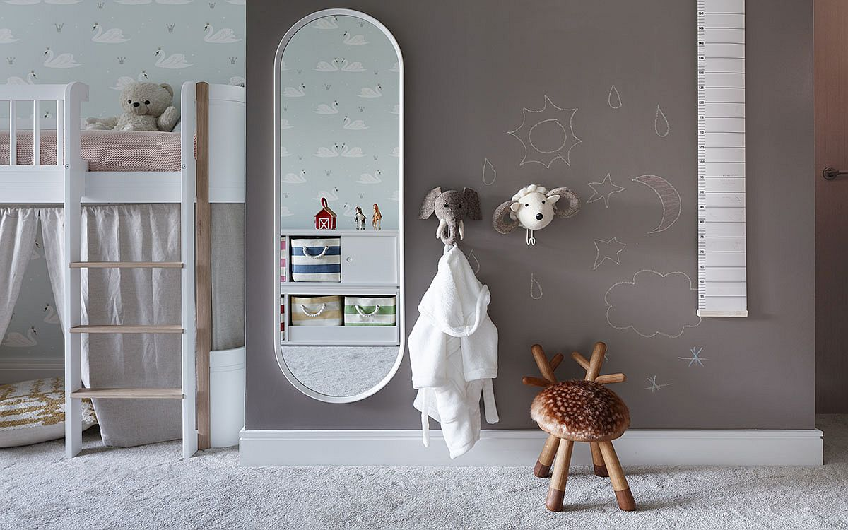 Gray accent wall for the kids' bedroom filled with light hues and custom decor