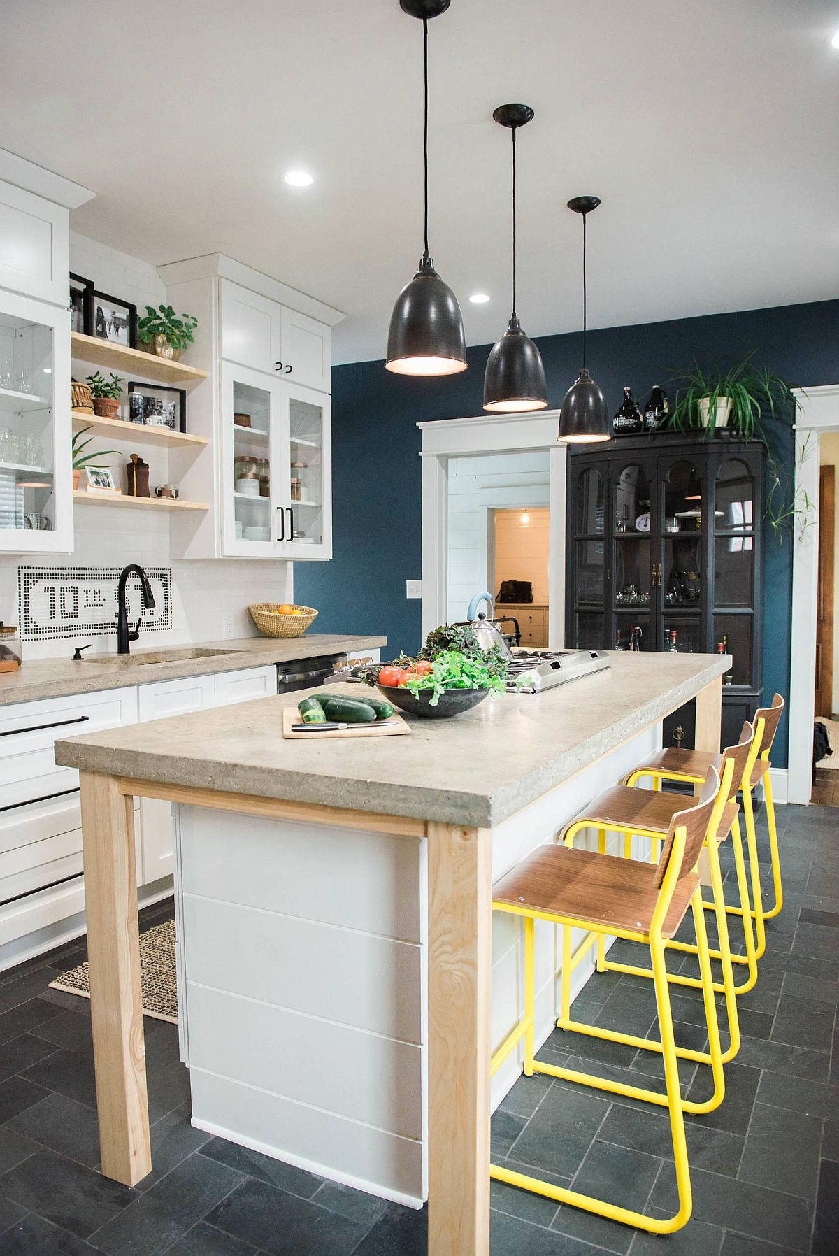 Ingenious small kitchen of New York home with lovely concrete countertops