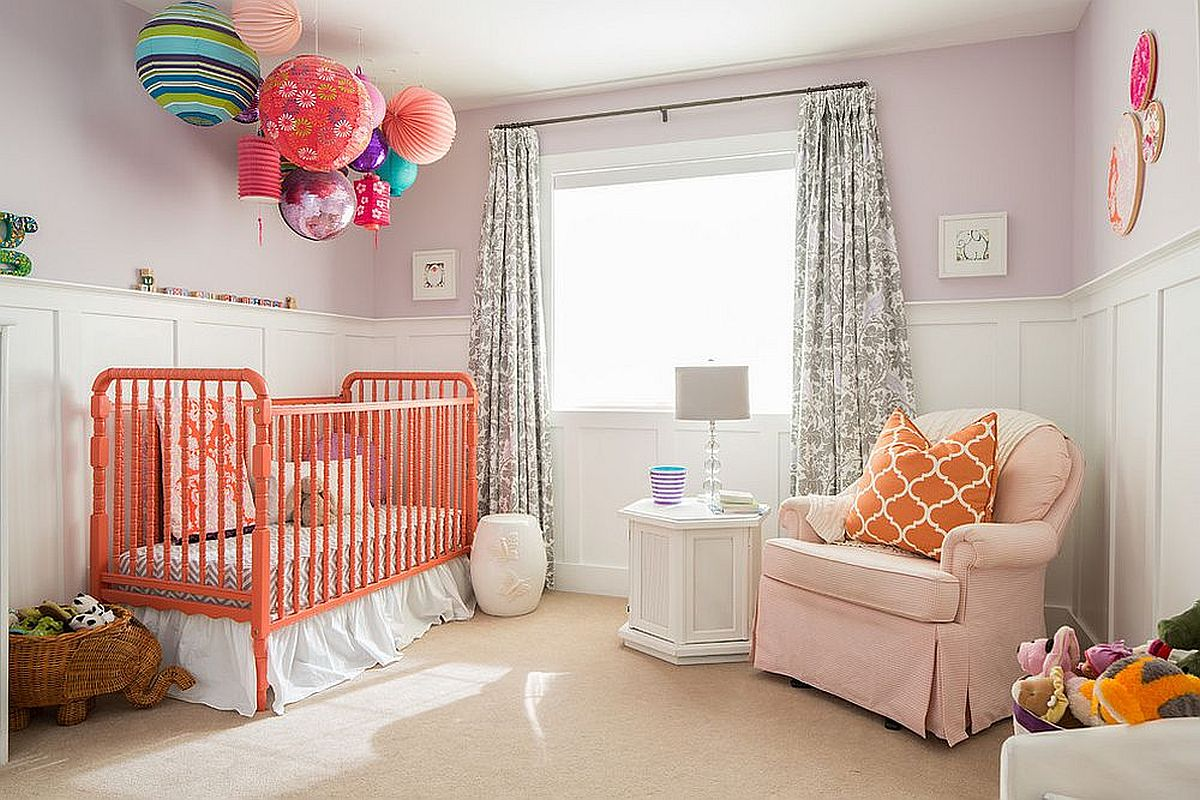 It is the crib and throw pillow that bring bright coral brilliance to this modern white nursery
