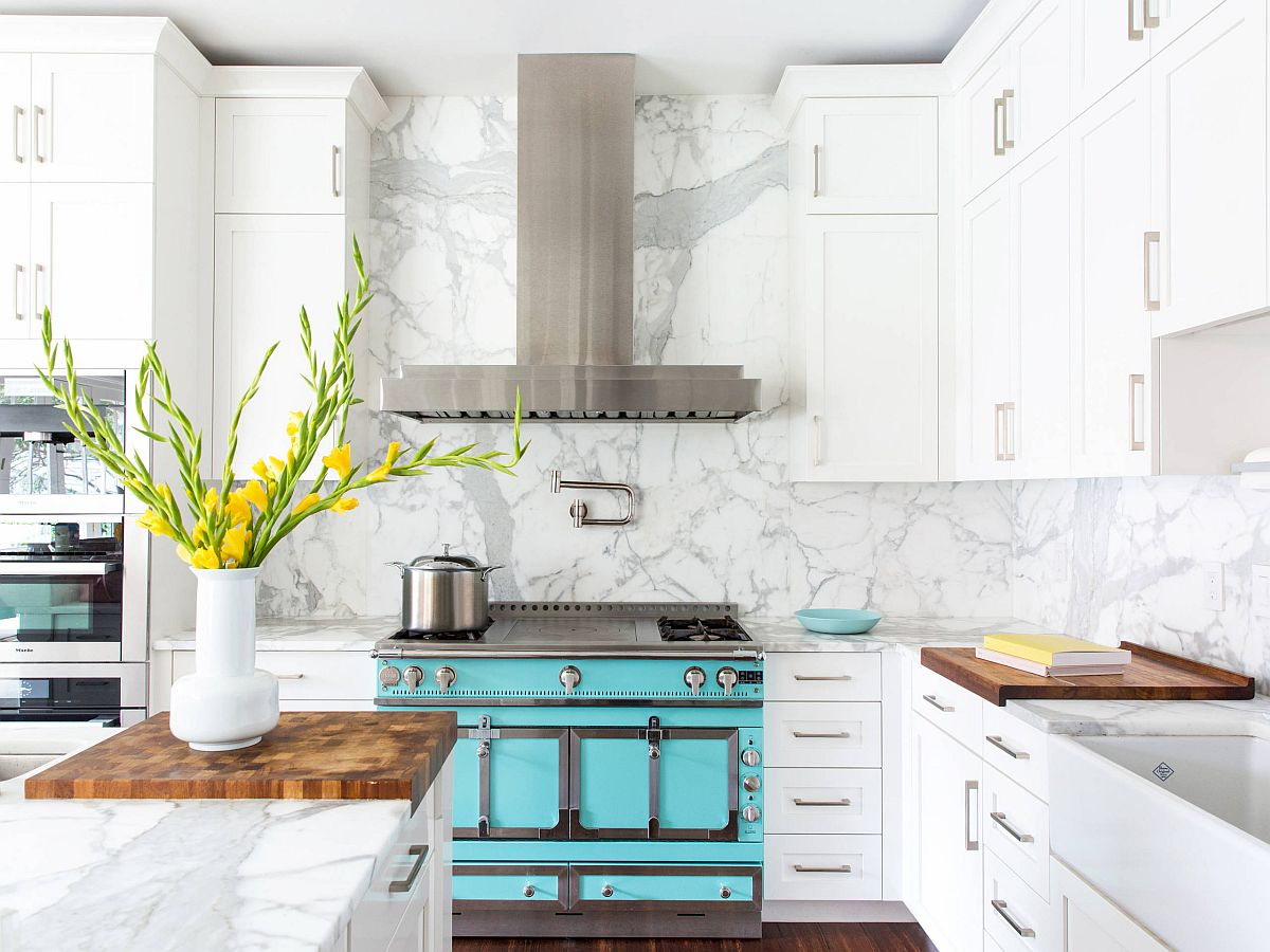 Kitchen appliances and accent additions bring color to this neutral modern kitchen