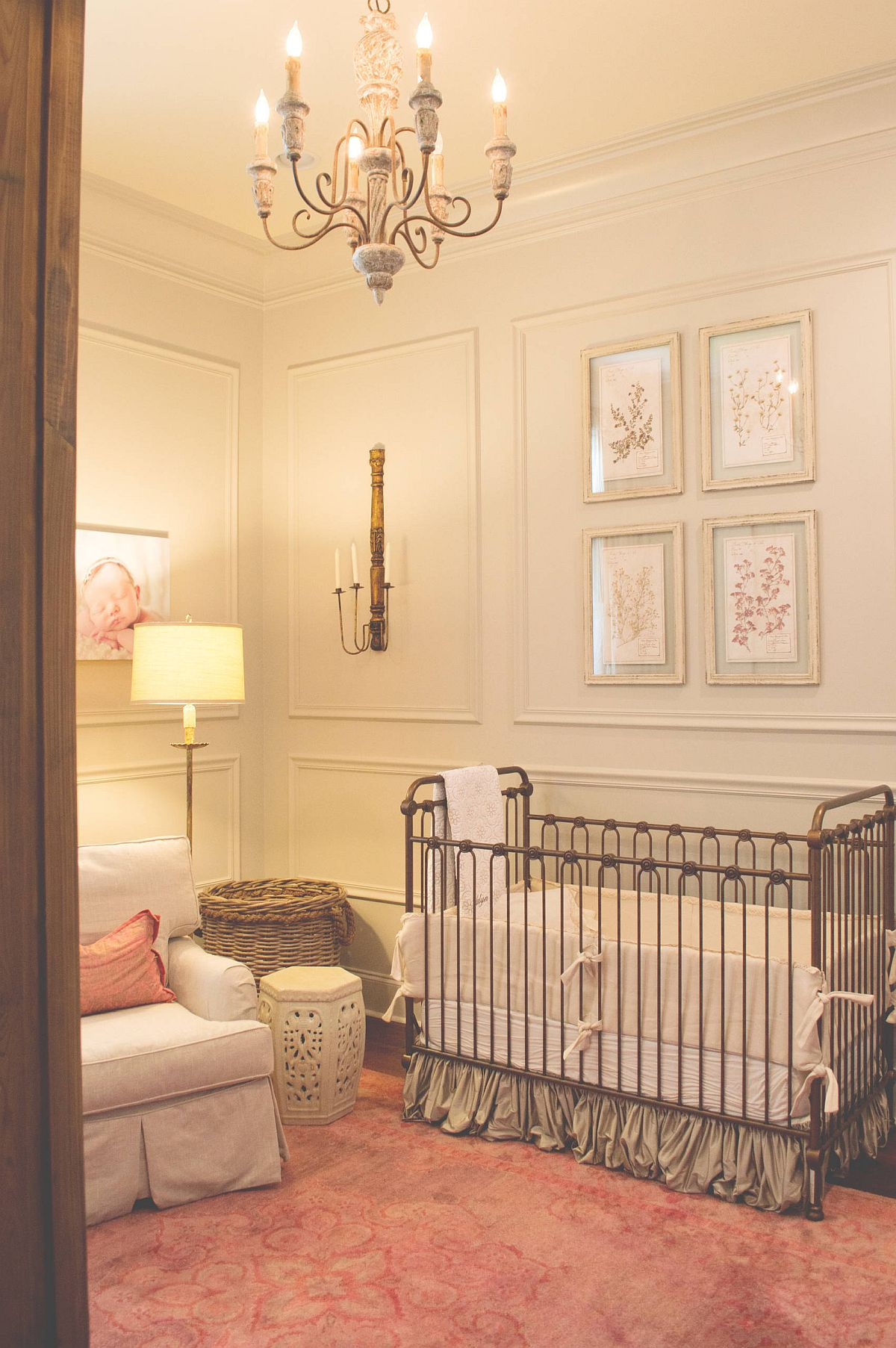 Light pinkish-orange accents and rug add an understated colorful charm to this traditional nursery