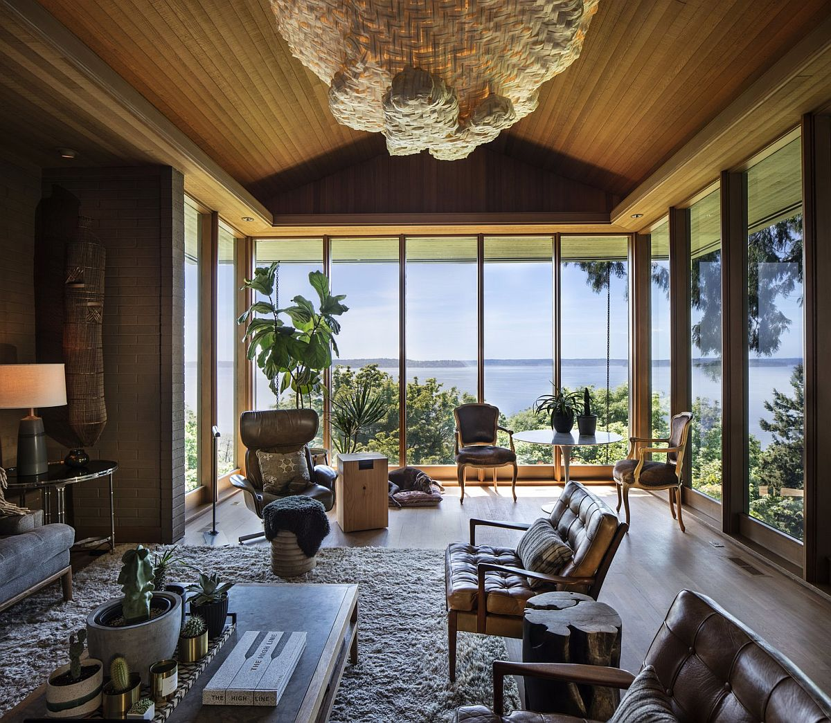 Living room nestled on the edge of the cliff offers some of the most amazing views at the house