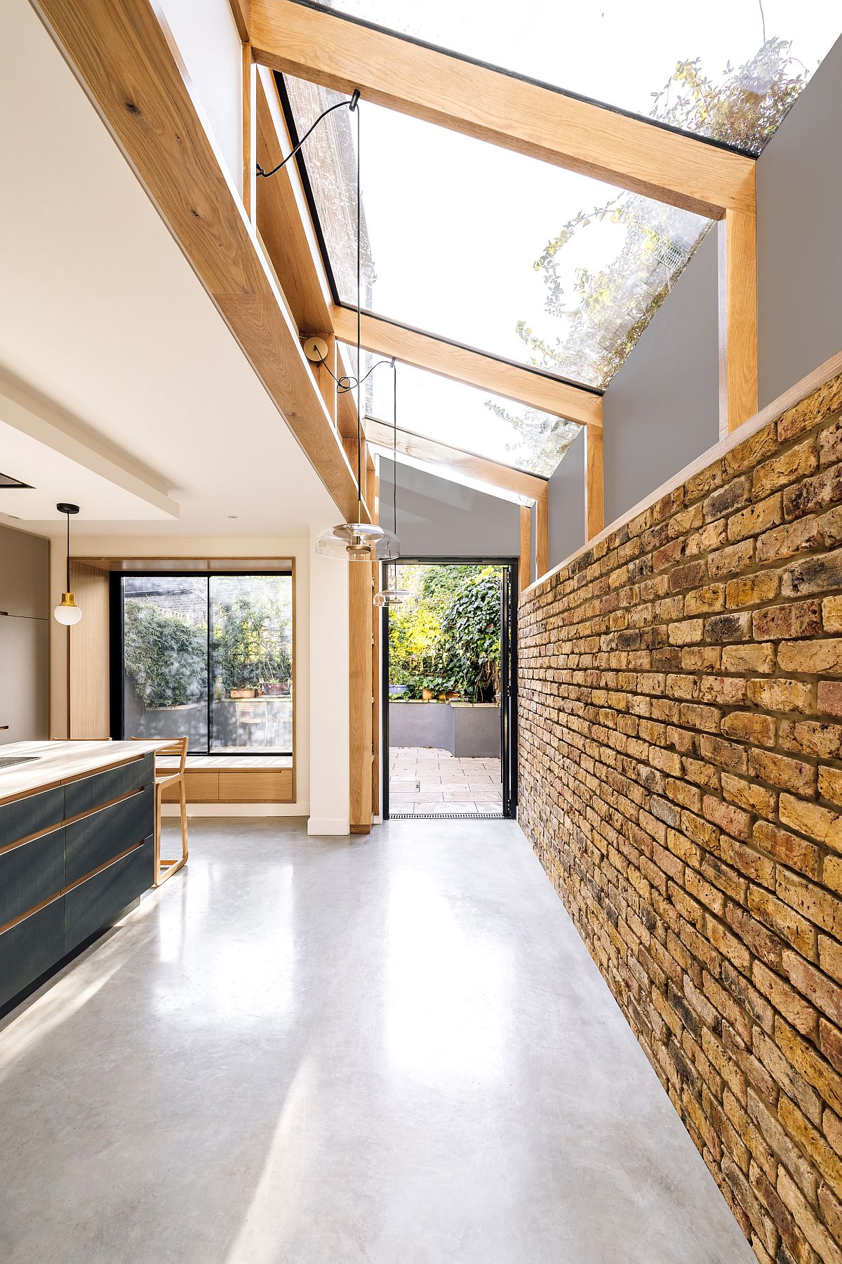Lovely extensive roof light of the kitchen brings natural light into an aging Victorian home