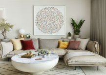 Low-slung-sectional-in-white-coupled-with-gorgeous-wall-art-and-a-custom-coffee-table-42069-217x155