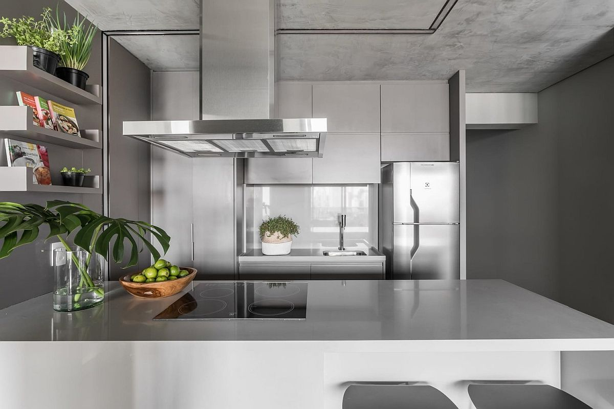 Metal and polished gray surfaces shape this gorgeous modern kitchen