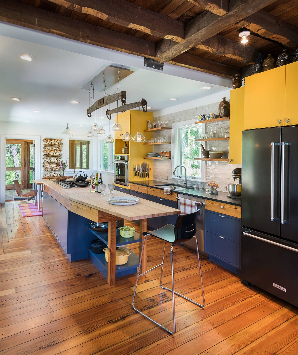 Modern farmhouse kitchen with brilliant splashes of yellow and blue thrown into the mix