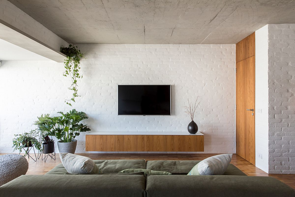 Modern industrial apartment in Sao Paulo with painted brick walls and exposed concrete ceiling