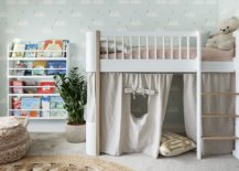 Modern-kids-room-with-bunk-bed-that-has-playarea-underneath-and-bookshelves-next-to-it-32423-217x155