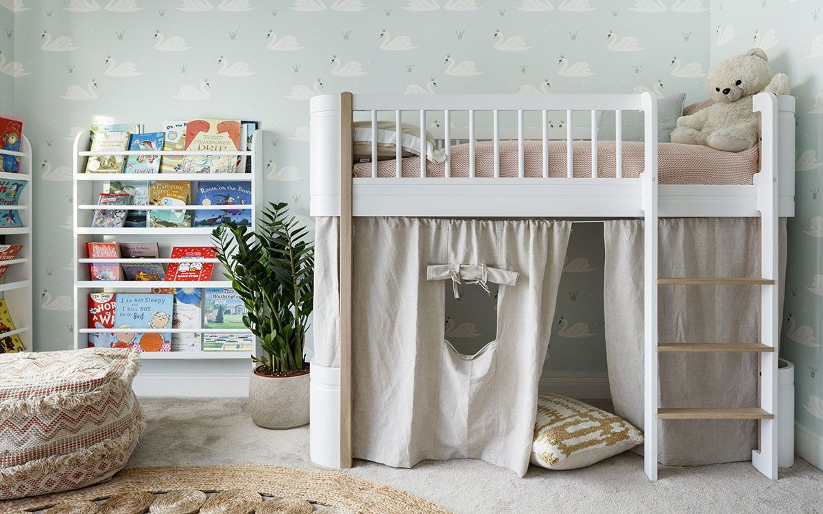 Modern-kids-room-with-bunk-bed-that-has-playarea-underneath-and-bookshelves-next-to-it-32423