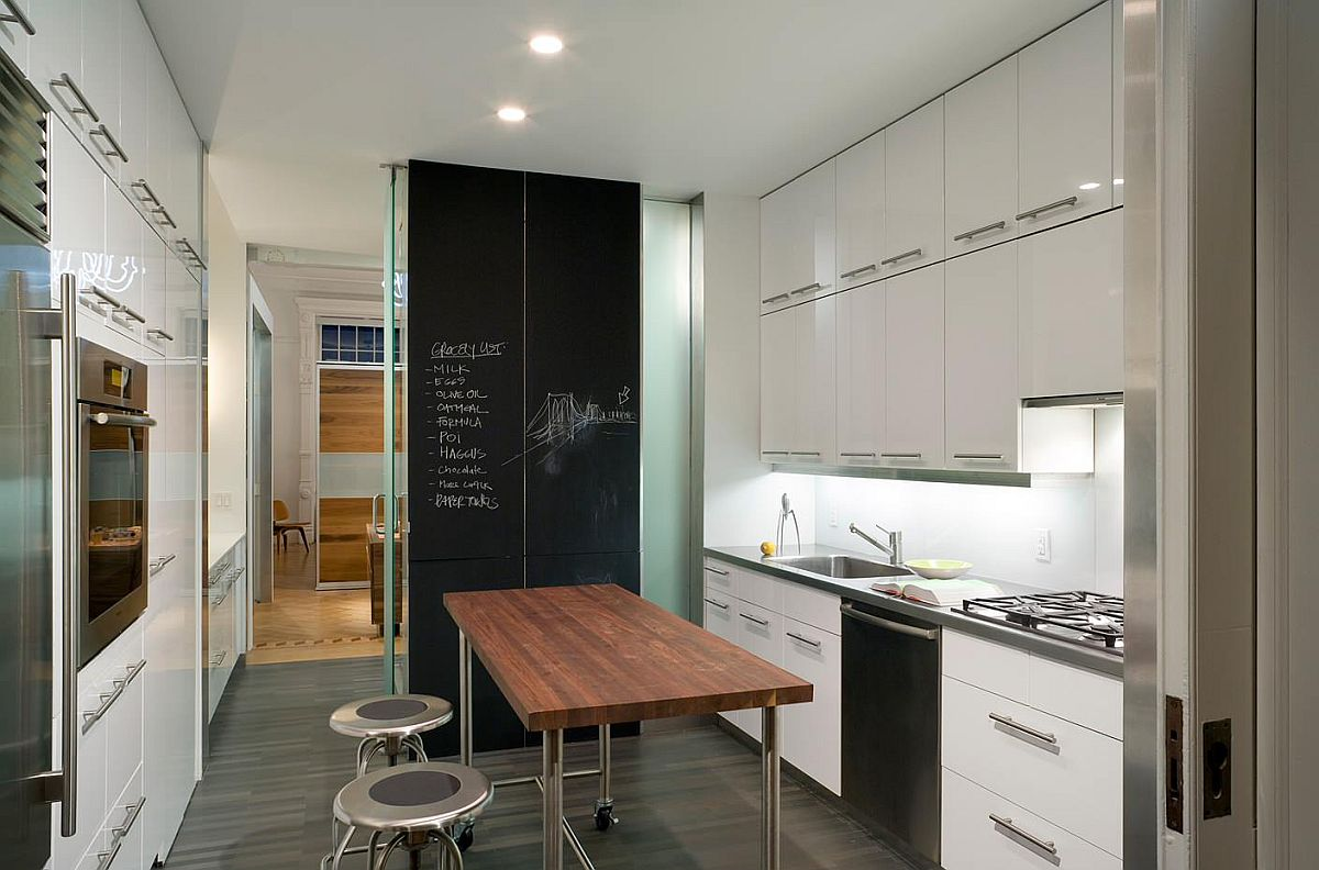 Modern kitchen with open island in steel and chalkboard wall in the backdrop