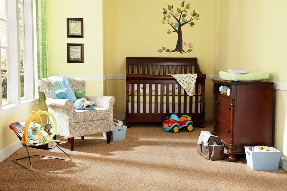 Modern yellow and gray nursery with a relaxing vibe and cheerful ambiance