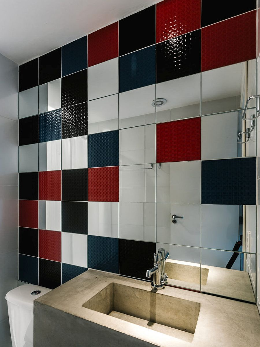 Multi-color tiled walls in the kitchen with black, red and blue tiles