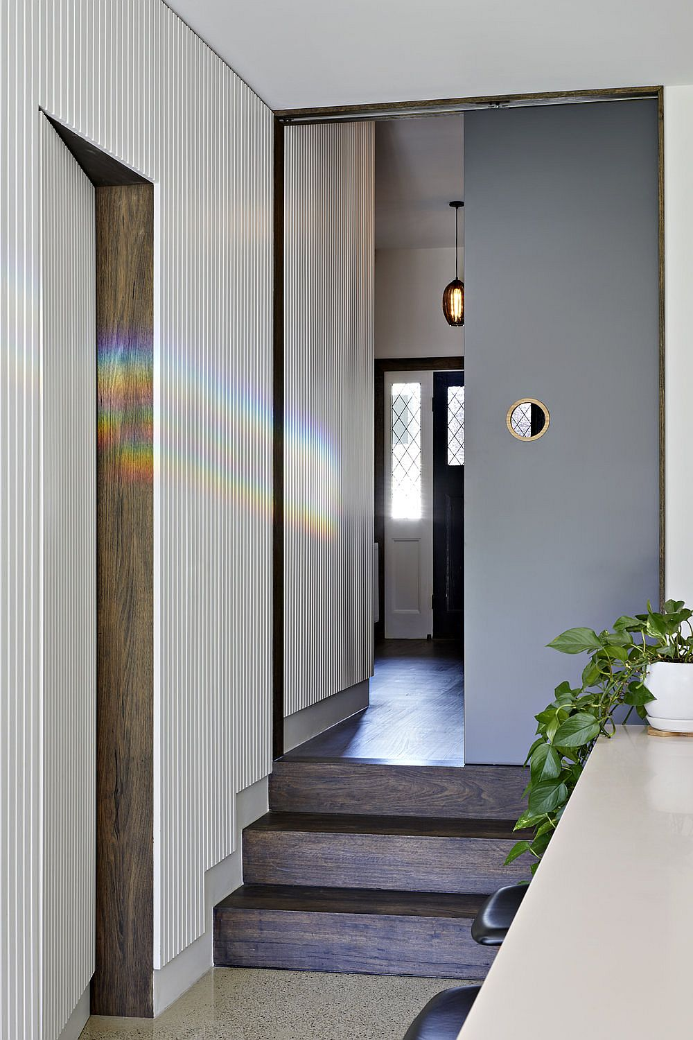 Natural lighting and sliding doors create a space-savvy and cheerful interior