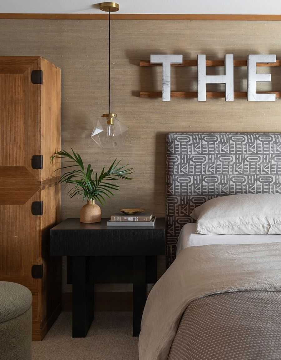 Pendant, decor and custom wall additions bring modern minimalism to the bedroom of the midcentury home