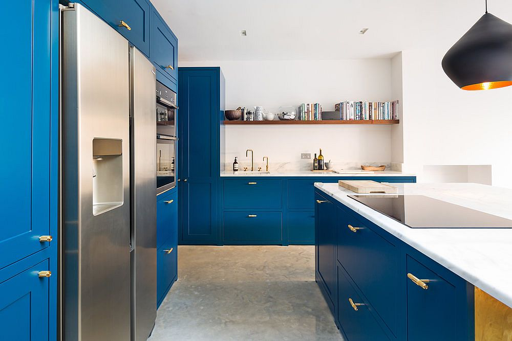 Picture-perfect modern kitchen in navy blue and white with a large central island