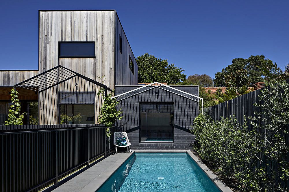 Pool area and small deck of the house with smart rear extension in wood