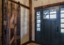 Reclaimed-wood-ceiling-is-coupled-with-a-gorgeous-sliding-barn-door-to-create-a-dashing-modern-rustic-entry-for-this-New-York-home-99785-217x155