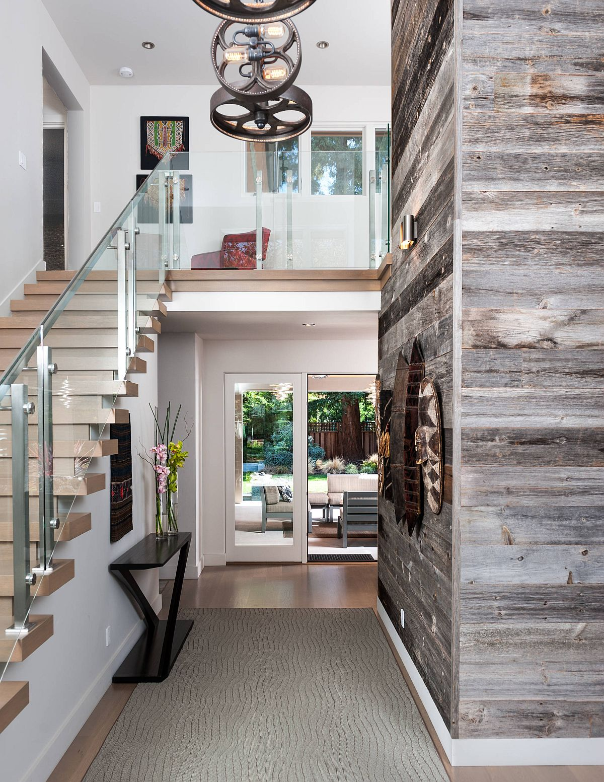 Reclaimed wood wall add style and textural contrast to the spacious contemporary entry