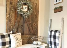 Reclaimed-wooden-bench-and-old-barn-door-are-used-to-decorate-this-modern-rustic-enryway-76118-217x155
